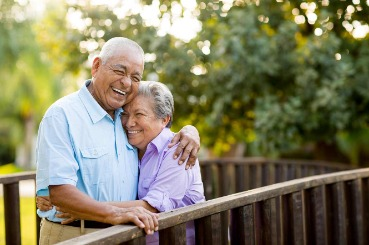couple, outdoors, deck, laughing, happy, retiree